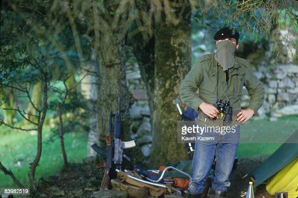 A trainee member of the Provisional Irish Republican Army at a camp set up during a guerilla warfare training session at a secret location in the...