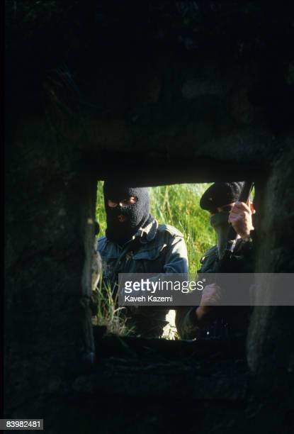 Trainee members of the Provisional Irish Republican Army during an armed assault practice on the ruins of a building at a secret location in the...