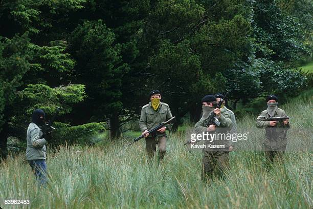Trainee members of the Provisional Irish Republican Army practice guerilla warfare tactics at a secret location in the countryside outside the town...