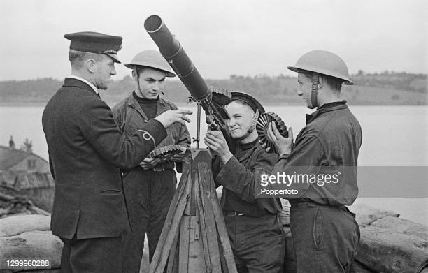 Trainee Merchant Navy bosun Robin Alway Hall receives instructions on how to handle and aim a Lewis gun from an instructor at Sharpness Port in...