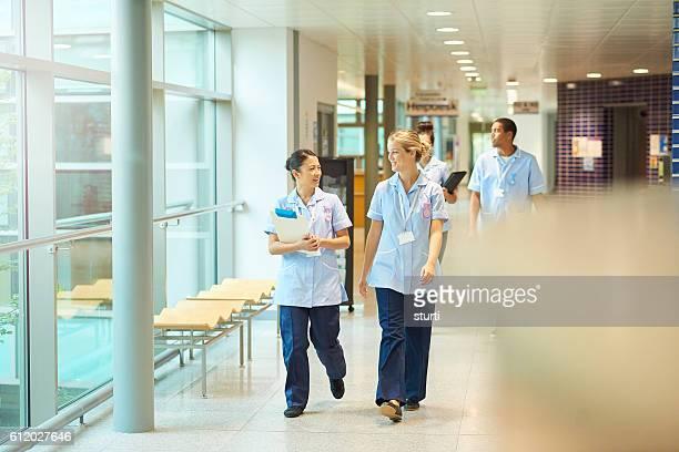 trainee nurses on the way to ward .