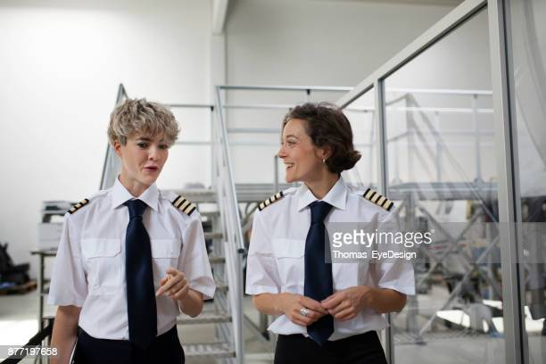 Trainee Pilot And Her Instructor Talking Before Training