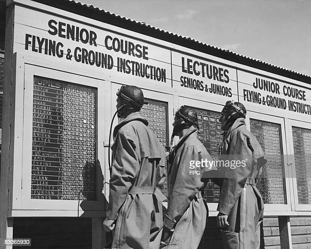 Trainee pilots study the notice board at a Royal Australian Air Force elementary flying school, circa 1940.