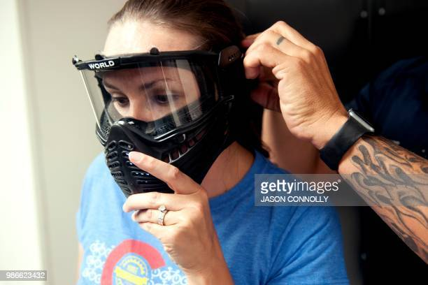A trainee puts on face protection before participating in an Airsoft active shooter drill during a three day firearms course sponsored by FASTER...