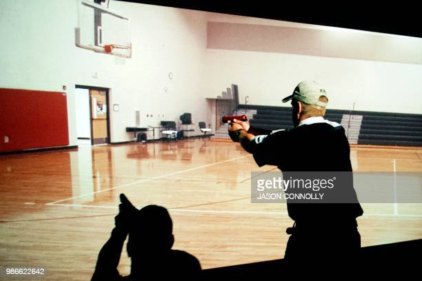 A trainee takes part in a simulated active shooter drill during a three day firearms course for school teachers and administrators sponsored by...