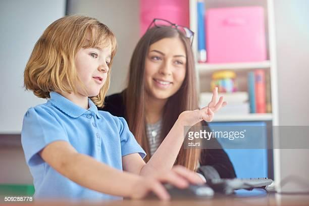 trainee teacher listening to schoolgirl