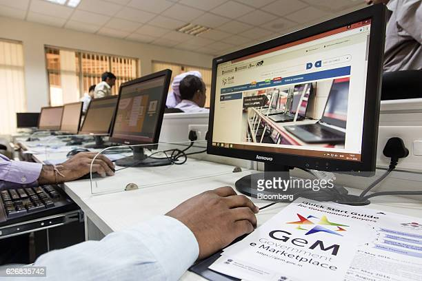 A trainee uses a mouse while sitting in front of a computer screen displaying the Government e Marketplace website during a class at the National...