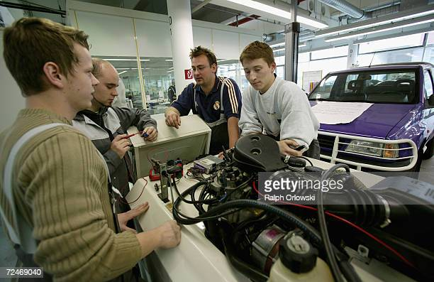 Trainees in car mechanic learn skills for car mechatronics at the training center of German car maker Opel AG November 3 2006 in Ruesselsheim Germany...
