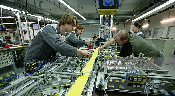 Trainees in electronics and mechanics learn skills for mechatronics at the training center of German car maker Opel AG November 3 2006 in...