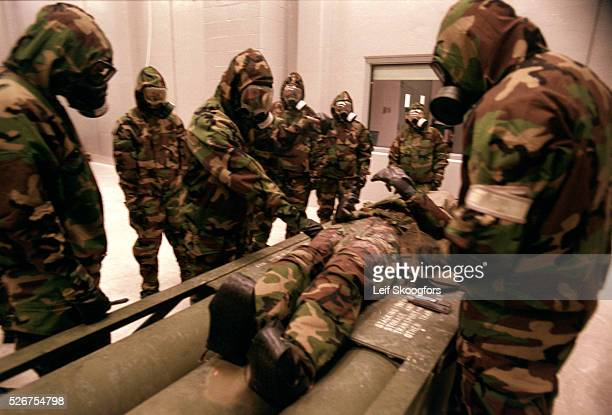 Trainees practice using self-injectors to counter the effects of nerve agents. The self-injector is placed against the thigh of a victim , the needle...