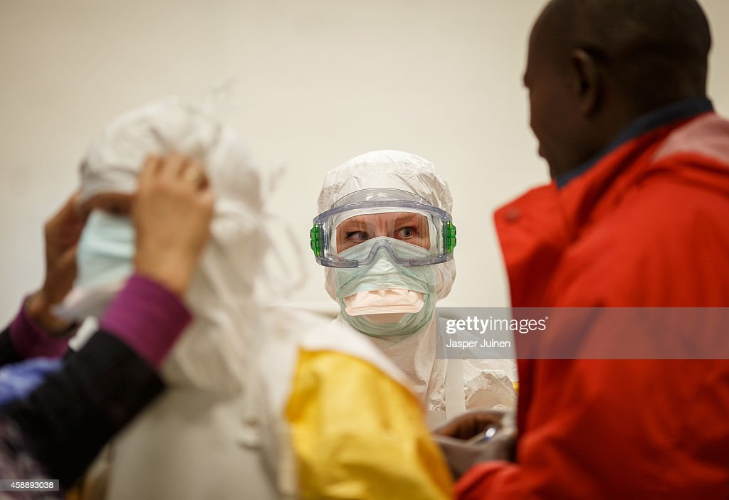 Trainees wear protective clothing during the Ebola training program on November 12, 2014 in Amsterdam, Netherlands. Doctors Without Borders has established a training program in a reproduction field hospital build in an old factory, without electricity and running water, in the Dutch capital for medical personnel world wide who are being sent to countries where Ebola is rife. The charity says it needs hundreds of doctors who are willing and sufficiently skilled to go to Africa to try to help combat the epidemic. The training centre in Amsterdam is the second of its kind after Brussels.