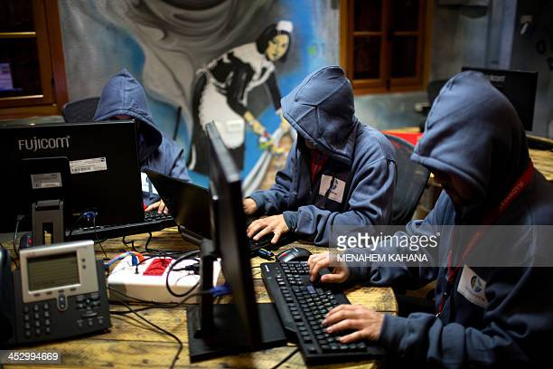 DAVISON Trainees work in front of their computers at the 'Cyber Gym' center where IT and infrastructure company employees train to defend against...