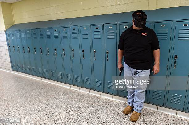 A trainer acting as an 'active shooter' lines up to attack a classroom during ALICE training at the Harry S Truman High School in Levittown...