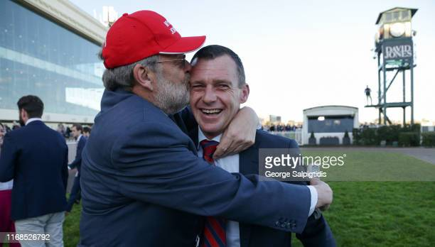 Trainer Adam Trinder is congratulated by owner Wayne Roser after Mystic Journey won Race 8 PB Lawrence Stakes during Melbourne Racing at Caulfield...