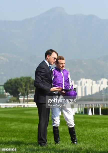 Trainer Aidan O'Brien poses with Ryan Moore after Highland Reel won Race 4 The Longines Hong Kong Vase during Longines Hong Kong International Race...