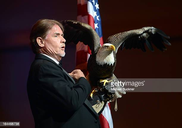 Trainer Al Cecere and a Bald Eagle attends Muhammad Ali's Celebrity Fight Night XIX at JW Marriott Desert Ridge Resort Spa on March 23 2013 in...