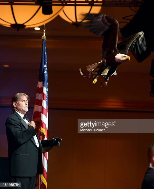 Trainer Al Cecere and a Bald Eagle attends Muhammad Ali's Celebrity Fight Night XIX at JW Marriott Desert Ridge Resort & Spa on March 23, 2013 in...