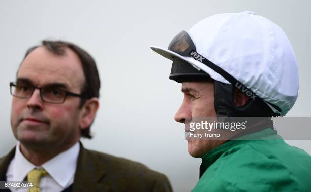 Trainer Alan King and Jockey Barry Geraghty look on prior to Yanworth running in the RGB Building Supplies Novices Chase at Exeter Racecourse on...