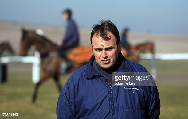 Trainer Alan King parades his Cheltenham National Hunt Festival bound horses at a media open day at hiis stables at Barbury Castle near Swindon on...