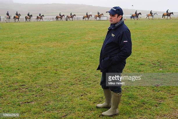 Trainer Alan King parades his horses during an Alan King stable visit at Barbury Castle Stables on February 22 2011 in Wroughton Wiltshire England