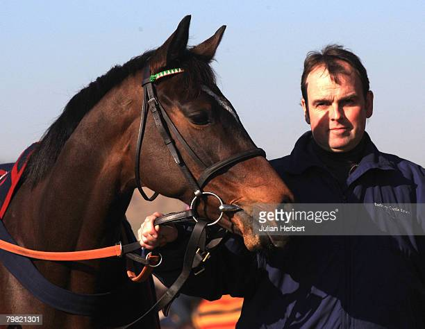 Trainer Alan King parades one of his Cheltenham national Hunt Festival bound horses Katchit at a media open day at hiis stables at Barbury Castle...