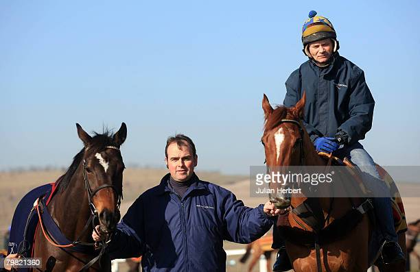 Trainer Alan King parades two of his Cheltenham national Hunt Festival bound horses Katchit and Franchoek with Michael O' Brien at a media open day...