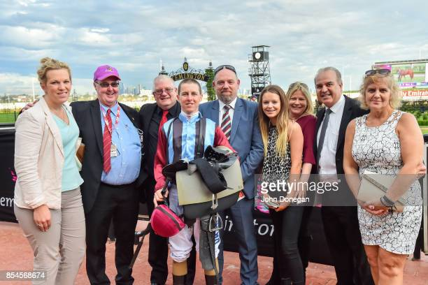 Trainer Amy Johnston and jockey Damian Lane pose with connections after winning the Wallace Handicap at Flemington Racecourse on September 27 2017 in...