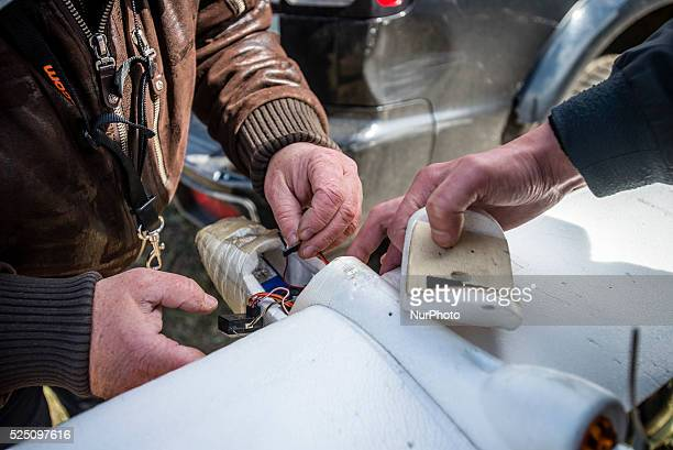 Trainer and his student repair drone used for training Ukrainian soldiers to control unmanned aerial vehicle in the field at Training Center of...