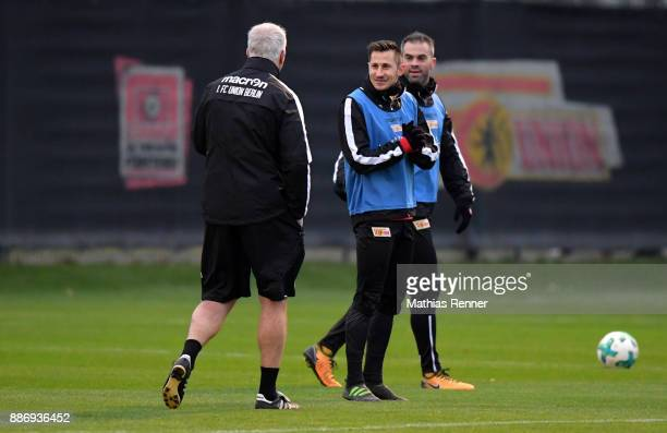 Trainer André Hofschneider Steven Skrzybski and Marc Torrejon of 1 FC Union Berlin during the 1 FC Union Berlin training on December 6 2017 in...