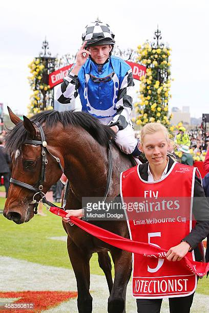 Trainer Andreas Wohler and jockey Ryan Moore celebrate after combining to win with Protectionist in race 7 the Emirates Melbourne Cup on Melbourne...