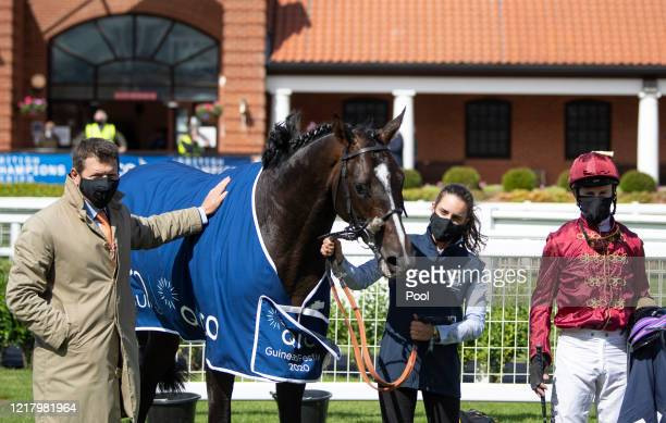 Trainer Andrew Balding and jockey Oisin Murphy pose with Kameko in the winners enclosure after the Qipco 2000 Guineas at Newmarket Racecourse on June...
