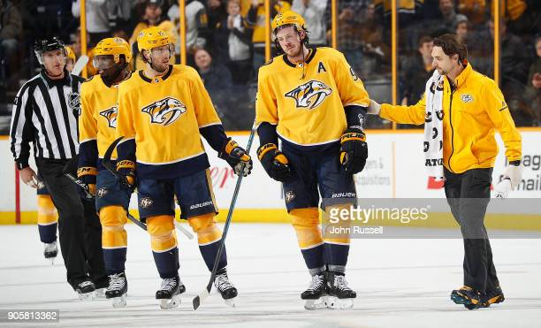 Trainer Andrew Hosler assists Ryan Johansen of the Nashville Predators to the bench after a hit during an NHL against the Vegas Golden Knights game...