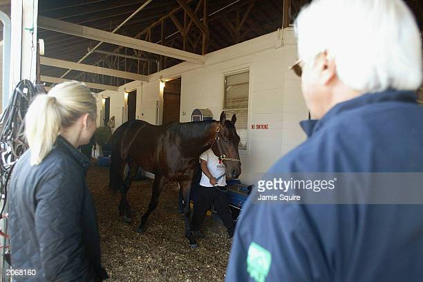 Trainer Bob Baffert and wife Jill look on as Kentucky Derby entrant Indian Express is walked during morning workouts for the 129th Kentucky Derby on...