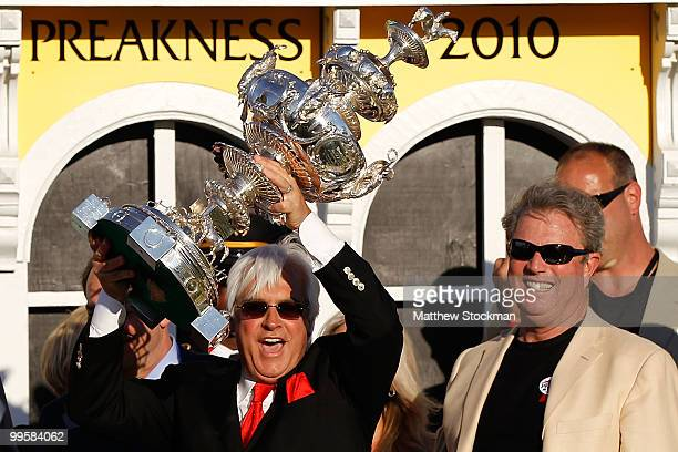 Trainer Bob Baffert celebrates in the winners circle after his horse Lookin at Lucky wins the 135th Preakness Stakes at Pimlico Race Course on May...