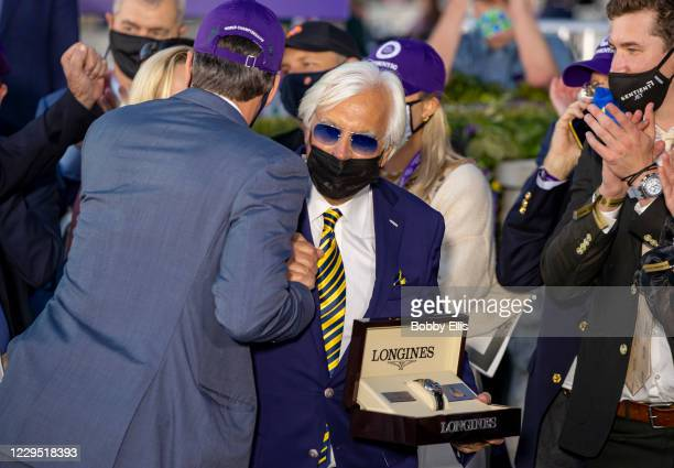 Trainer Bob Baffert celebrates with owners of Authentic after the horse won the Breeders Cup Classic at Keenland on November 7, 2020 in Lexington,...
