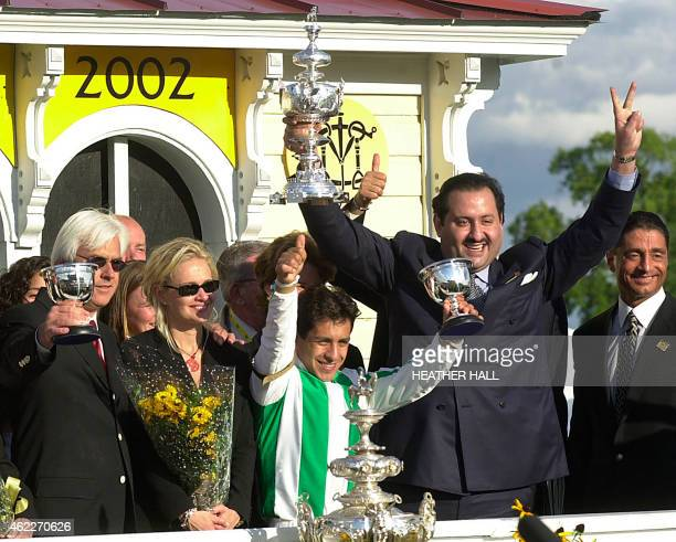 Trainer Bob Baffert Jill Moss jockey Victor Espinosa and owner Saudi Prince Ahmed bin Salman celebrate after War Emblem won the 127th running of the...