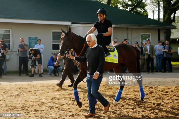 Trainer Bob Baffert leads Game Winner to the track for morning workouts in preparation for the 145th running of the Kentucky Derby at Churchill Downs...