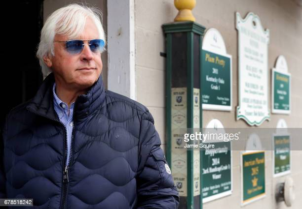 Trainer Bob Baffert looks out from his stable during morning workouts ahead of the 143rd Kentucky Derby at Churchill Downs on May 4, 2017 in...