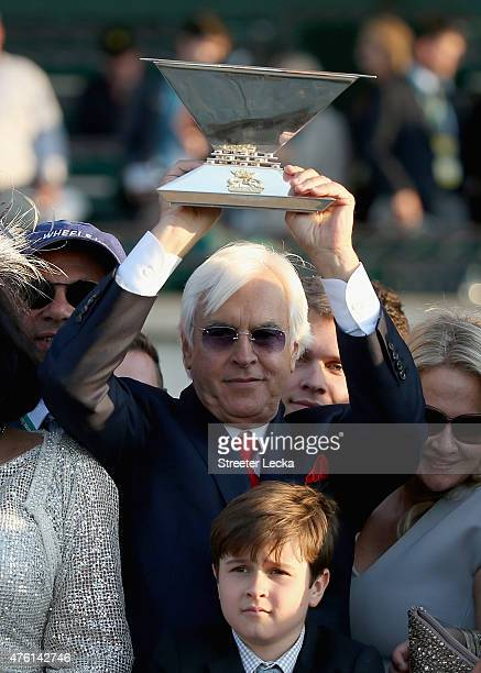 Trainer, Bob Baffert, of American Pharoah celebrates with the Triple Crown Trophy after winning the 147th running of the Belmont Stakes at Belmont...