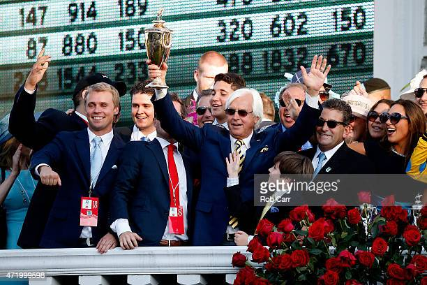 Trainer Bob Baffert of American Pharoah celebrates with the trophy in winners circle after winning the 141st running of the Kentucky Derby at...