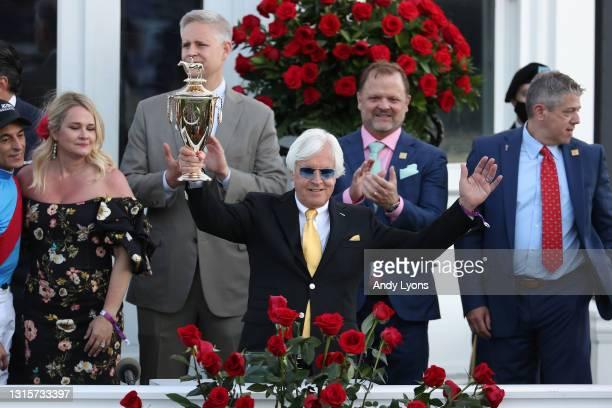 Trainer Bob Baffert of Medina Spirit, raises the trophy after winning the 147th running of the Kentucky Derby with Medina Spirit, his seventh career...