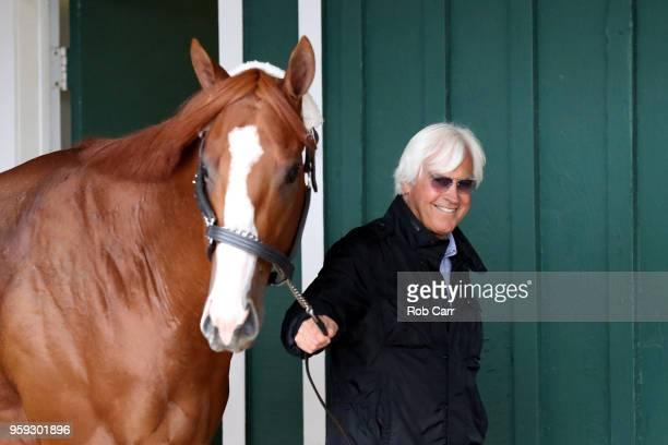 Trainer Bob Baffert walks Kentucky Derby winner Justify in the barn after the horse arrived at Pimlico Race Course for the upcoming Preakness Stakes...