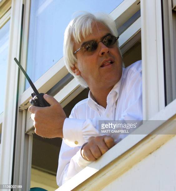 Trainer Bob Baffert watches from an observation tower as favorite Point Given works out 08 June 2001 at the Belmont Racetrack in Elmont NY Point...