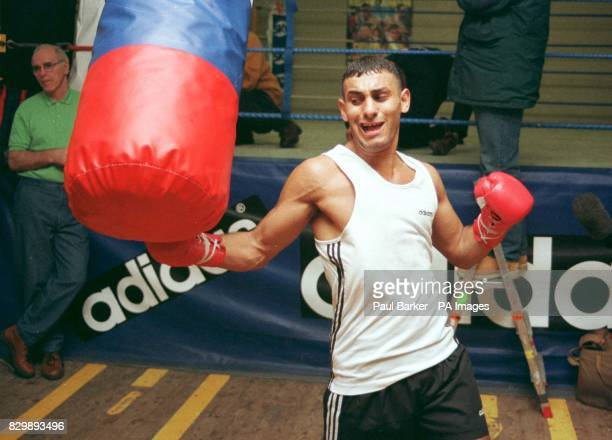 Trainer Brendan Ingle looks on as world champion boxer Prince Naseem Hamed trains today in preparation for his upcoming fight against Tommy 'Boom...