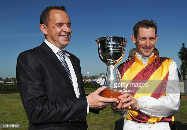 Trainer Chris Waller poses with trophy with Hugh Bowman after winning on Preferment in Race 7 the Yellowglen Turnball Stakes during Turnbull Stakes...