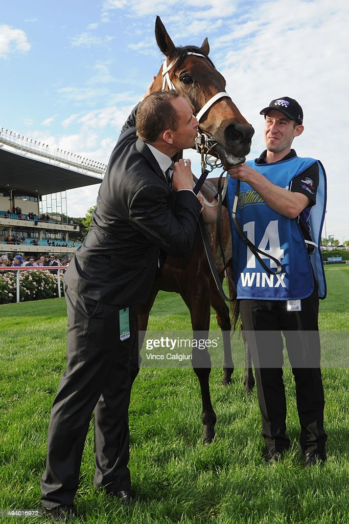 Trainer Chris Waller poses with Winx after winning Race 9, the William Hill Cox Plate during Cox Plate Day at Moonee Valley Racecourse on October 24, 2015 in Melbourne, Australia.
