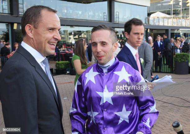 Trainer Chris Waller talks to Brenton Avdulla after winning race 8 with Cellerman during Sydney Racing at Rosehill Gardens on March 31 2018 in Sydney...