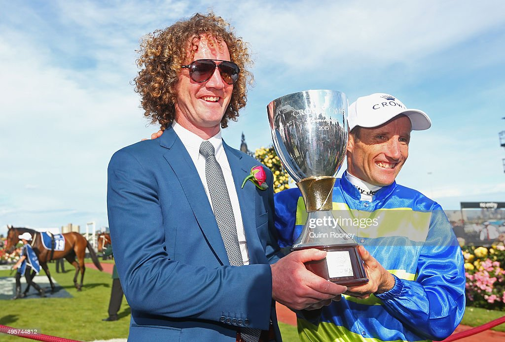 Trainer Ciaron Maher and Jockey Damien Oliver who rode Jameka to win race 8 the Crown Oaks pose with the trophy on Oaks Day at Flemington Racecourse on November 5, 2015 in Melbourne, Australia.