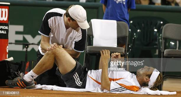 ATP trainer Clay Sniteman works on Marcos Baghdatis' lower back Baghdatis could not continue the matchVincent Spadea defeated Marcos Baghdatis 62...