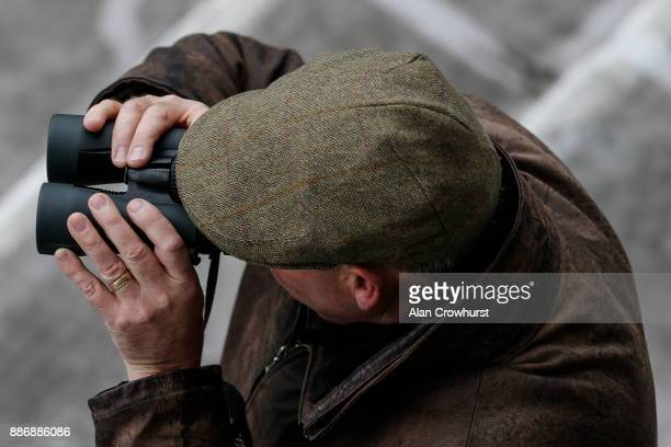 Trainer Clive Cox watches the action at Lingfield Park racecourse on December 6 2017 in Lingfield United Kingdom